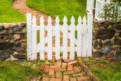 Garden gate and brick path Stock Photo