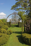 Garden gate. Country house garden and gate with topiary Stock Images