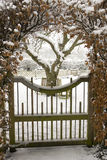Garden gate covered in snow. Garden gate and lawn covered in snow stock photography