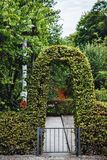 Garden gateway arc perfectly bent and groomed. Summer time or sp. Ringtime Royalty Free Stock Image