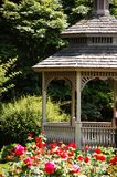 Garden gazebo. With flowers in park Stock Image