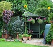 Free Garden Gazebo, Flowerpots And Sunflowers Stock Images - 47865864