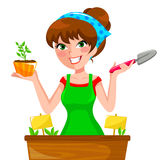 Garden girl. Young woman planting herbs in her planter Stock Photos