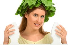 Garden girl - lettuce on hair stock photography