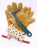 Garden Gloves. A pair of garden gloves and a paving scraper Stock Image