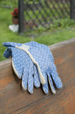 Garden gloves on bench Royalty Free Stock Photo