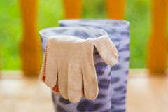 Garden gloves and rubber boots Royalty Free Stock Images