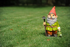 Garden Gnome. Photograph of a garden Gnome on the lawn with space to left for copy Royalty Free Stock Photos