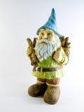 Garden Gnome. A cute garden gnome collecting firewood stock photography