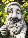 Garden Gnome. With yellow flowers Royalty Free Stock Photography