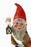 Garden gnome holding lantern Stock Photo