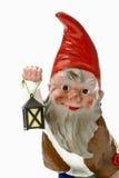 Garden gnome holding lantern Stock Photo