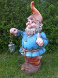 Garden Gnome with a lantern Stock Images