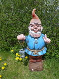 Funny garden gnome Stock Photo
