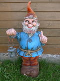 Garden Gnome with a lantern Stock Photo