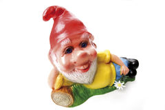 Garden gnome lying on meadow Royalty Free Stock Photo