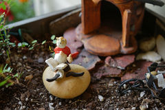 Garden gnome reading with a friend Royalty Free Stock Photo