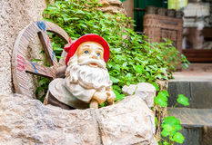 Garden gnome with a red hat. Stock Photography