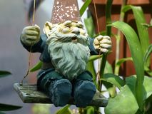 Swinging Garden Gnome Stock Images
