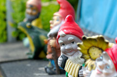 Garden gnomes. A row of garden gnomes stock images