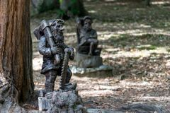 Garden gnomes carved out of wood for garden. Decoration royalty free stock photography