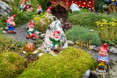 Garden gnomes in a garden of a house at Engelberg Stock Image