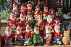 Garden Gnomes on sale. Ornamental garden gnomes or dwarfs terracotta clay slip runny clay on sale in a souvenir shop in Horezu, Gorj county, Romania stock photo
