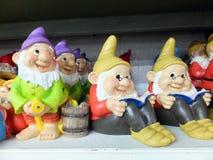 Garden Gnomes. A Shelf Full of Garden Gnomes stock photos
