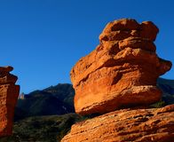 Garden of the Gods Balancing Rock. A boulder seemingly balancing on top of a rock formation in the Garden of the Gods Colorado royalty free stock photo
