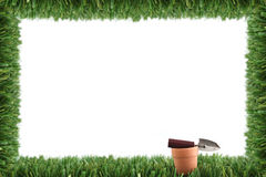 Garden grass frame and pot. With trowel stock photography