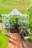 Garden greenhouse. Green house of gardener with all his tools Stock Images