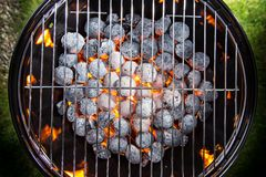 Garden grill with blistering briquettes Royalty Free Stock Image