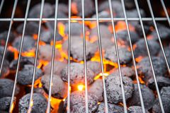 Garden grill with blistering briquettes Stock Image