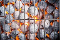 Garden grill with blistering briquettes Stock Photography