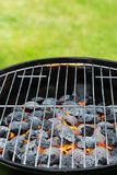 Garden grill with blistering briquettes Royalty Free Stock Images