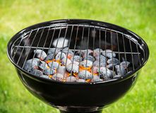 Garden grill with blistering briquettes Stock Photo
