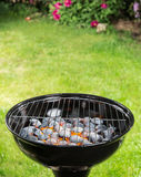 Garden grill with blistering briquettes. Stock Image