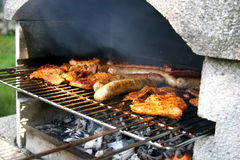 Garden grill with steaks and sausages Royalty Free Stock Images