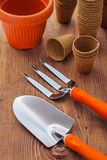 Garden hand tools and pots on wooden baords Royalty Free Stock Photo
