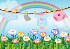 A garden with hanging baby clothes Stock Image
