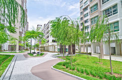 Garden within high-rise residential estate. Typical landscaped and green area of high-rise residential estate in Singapore. Comes complete with a playground for stock photography