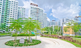 Garden within high-rise residential estate. Typical landscaped and green area of high-rise residential estate in Singapore. Comes complete with a playground for Stock Photo