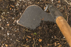 Garden Hoe in Soil Royalty Free Stock Photos