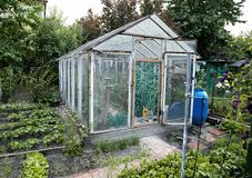 Garden homemade greenhouse with cold frame. Stock Images