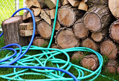 Garden Hose. A garden hose leaning against wood royalty free stock photography
