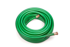 Garden hose. A new green coiled rubber hose on a white background stock photos
