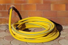Garden hose connected to faucet Stock Photography