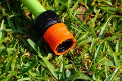 Garden hose connector. Garden hose connector on Mediterranean grass, Costa del Sol, Andalucia, Spain, Western Europe royalty free stock photography