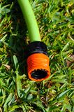 Garden hose connector. Garden hose connector on Mediterranean grass, Costa del Sol, Andalusia, Spain, Western Europe royalty free stock photo