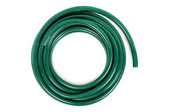 Garden hose. Curled garden hose isolated on white stock photography